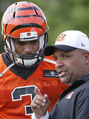 Quarterback Terrelle Pryor talks to Bengals offensive coordinator Hue Jackson during rookie camp on May 8.