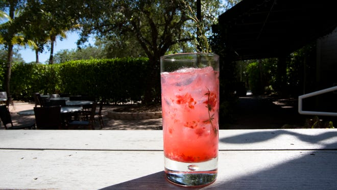 The Cocohatchee Cocktail, a signature drink by local restaurant and bar, The Bay House. (Erica Brechtelsbauer/Staff)