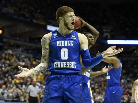 MTSU guard Tyrik Dixon (0) reacts to a call during