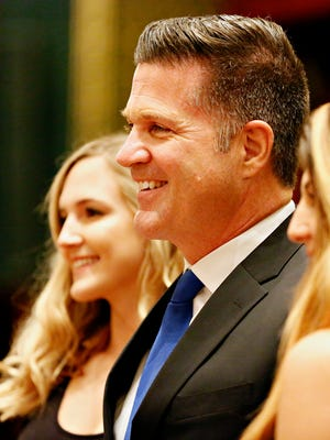 Senator Mike Regan, R-Carroll Township, center, poses with daughters Brooke, 16, left, and Shea, 21, prior to swearing-in ceremony at the Capitol in Harrisburg, Tuesday, Jan. 3, 2017. Dawn J. Sagert photo