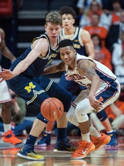 Michigan forward Moritz Wagner (13) and Illinois guard