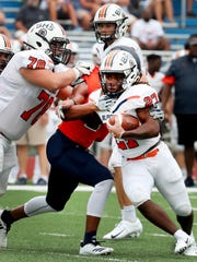 Blackman's Ta'micus Napier (27) runs the ball against Summit during the Williamson County/Rutherford County Jamboree game Aug. 9.