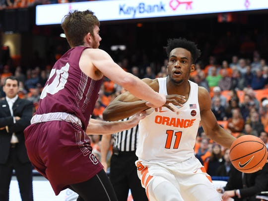 Syracuse Orange forward Oshae Brissett (11) drives to the basket as Colgate Raiders forward Will Rayman (10) defends during the first half at the Carrier Dome.