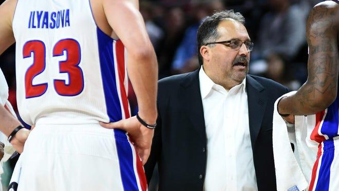 Detroit Pistons coach Stan Van Gundy, right, talks forward Ersan Ilyasova (23) against the Charlotte Hornets at the Palace of Auburn Hills.