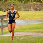 Shelby Smith, a cross country runner at Holy Trinity Episcopal Academy, is at the top of the Brevard County high school bests for 2015.