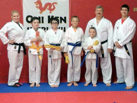 636330557988022122-0614yellowbluebelts.jpg