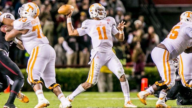 Tennessee Volunteers quarterback Joshua Dobbs (11) passes against the South Carolina Gamecocks in the second quarter at Williams-Brice Stadium.