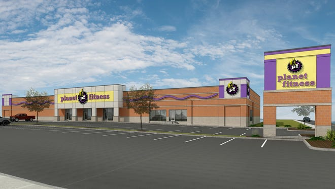 A rendering shows what the outside of the former Hastings building will look like once Planet Fitness is finished.