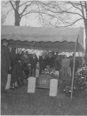 A photo from the graveside of Arthur Q. Smith in 1963.