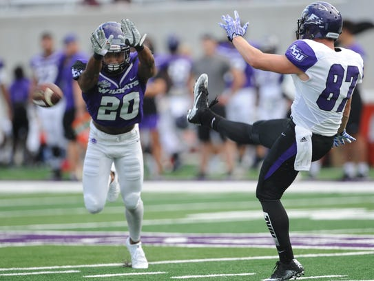 ACU safety A.J. Greathouse (20) almost blocks a punt