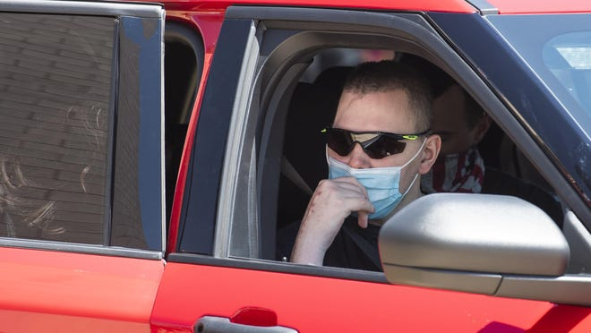 Lubbock Fire Rescue Firefighter Matt Dawson looks out the window as his vehicle gets ready to leave the reception at Lubbock Fire Administration on Thursday in Lubbock. Dawson has been in rehabilitation in Englewood, Colorado after being struck by a vehicle on I-27 on January 11, 2020.