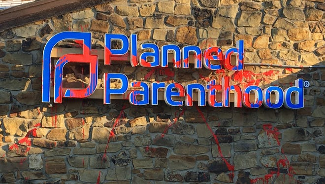 Vandals splattered the sign at a Planned Parenthood clinic in Columbus, Ind., with red paint, Wednesday, Nov. 1, 2017.