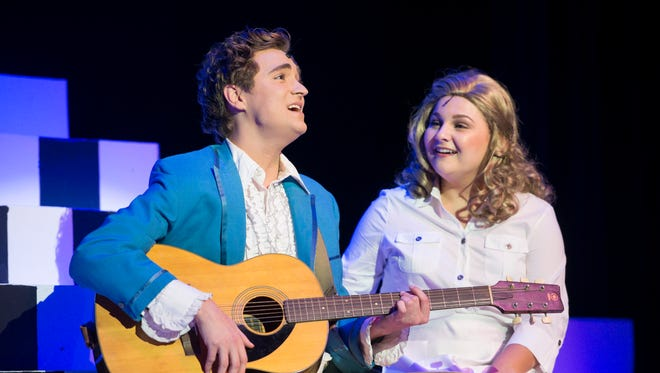 """Justin Gaylard as Robbie Hart, left, and Kendall Parrett as Julia Sullivan perform during rehearsal of """"The Wedding Singer"""" musical at the Pensacola Little Theatre in Pensacola on Tuesday, October 31, 2017."""