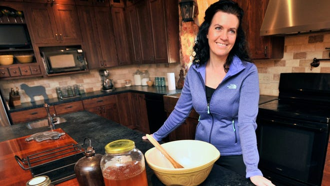 Jody Vasey stands in her kitchen at Water Girl Farm in Lincoln. She's been certified by the state Department of Agriculture's Food Safety for Entrepreneurs program, which teaches farmers about food safety.