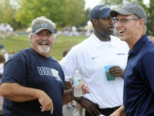 York County native and Penn State alumni Scott Fitzkee, left, and Mike Guman, teammates from the late 1970s, joke around while attending a Penn State alumni tailgate before a home game against Rutgers in September. The annual gathering started with just a few former players and has grown to include dozens.
