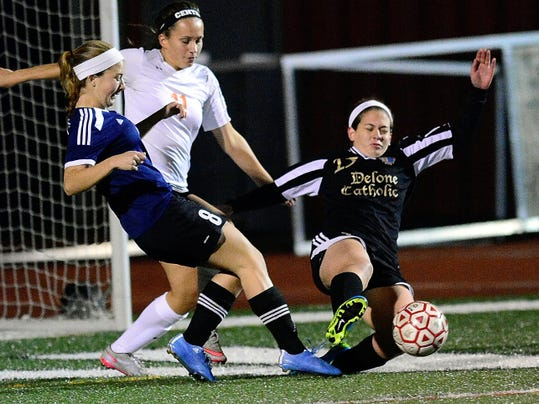 New Oxford's Kaitlyn Philipsen, left, Central York's Ally McCabe, middle, and Delone Catholic's Katie Roth battle for the ball during Wednesday's York-Adams League Girls' Soccer Senior All-Star Game at Dover High School.