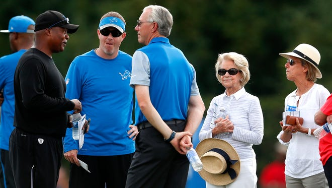 Detroit Lions coach Jim Caldwell, left, talks with general manager Bob Quinn, center left, president Rod Wood, center right, and owner Martha Ford in Allen Park on Monday, Aug. 1, 2016.