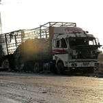 U.N. suspends aid to Syria after convoy attacked
