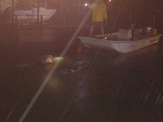 Eau Gallie Yacht Club employees rushed to a car that