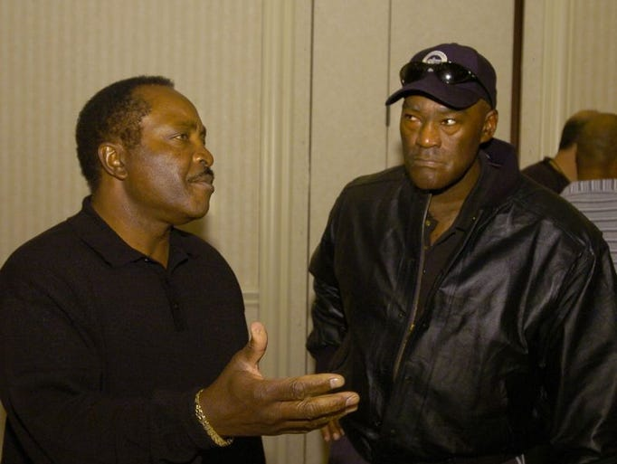 Left Joe Morgan talks with George Foster, two of the Cincinnati Reds from the Big Reds Machine that came to the Millennium for a sports memorabilia show. November 20, 2005