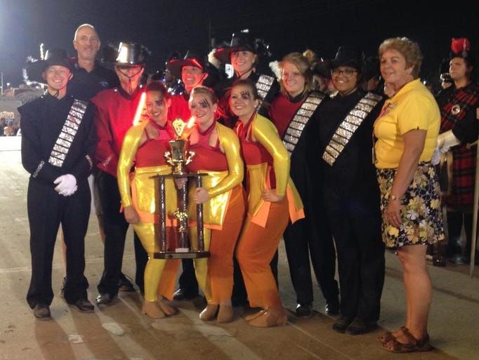 Richmond band leaders pose with the third-place trophy at Indiana State Fair Band Day.