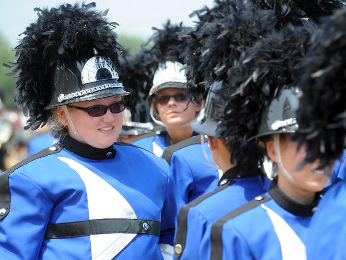 Centerville High School band members prepare for their performance at Indiana State Fair Band Day Saturday, Aug. 2, 2014.