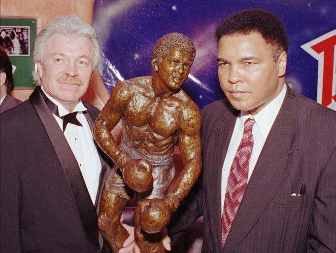 Muhammad Ali with artist John Petek of Billings, Montana, during the unveiling of the first-ever bronze sculpture of Ali April 21, l995, at Planet Hollywood in Las Vegas.