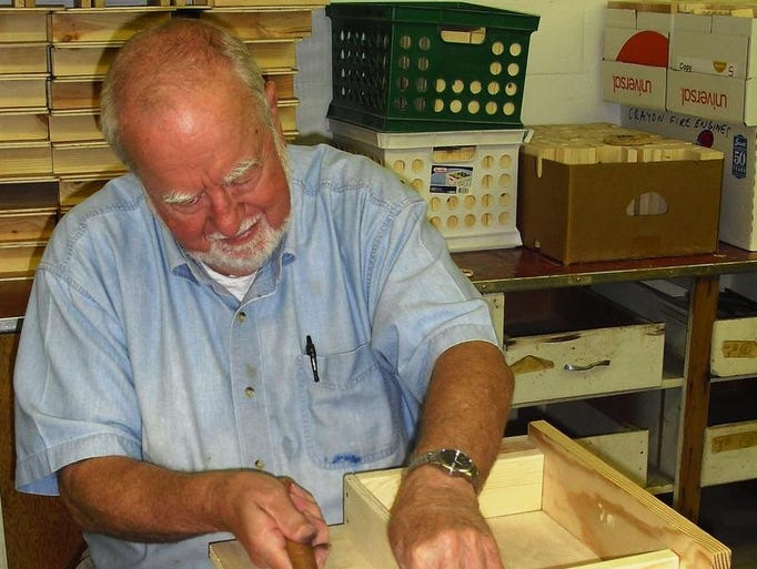 Okemos resident Tony Bauer assembles a memory box at the R. J. Scheffel Memorial Toy Project site in DeWitt Township. The boxes are especially appreciated by the grieving children at Ele's Place.