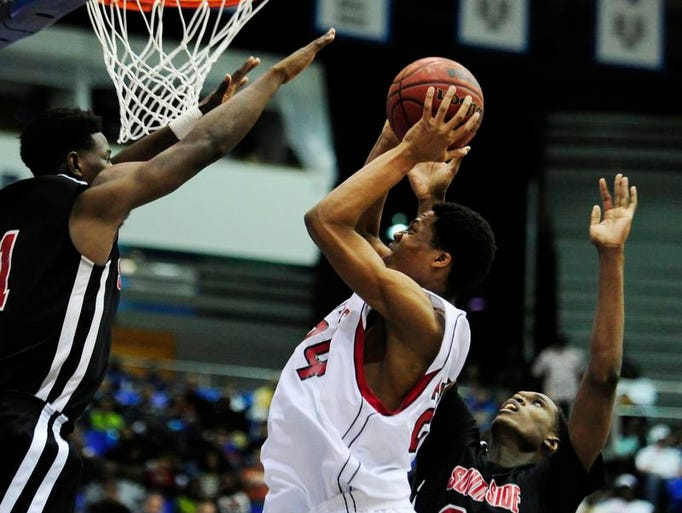 East Nashville's Isaiah Blacksmith (24) shoots against  Jackson South Side's Jaylen Barford (1) and Tyler Henning (32) during Class AA championship game at Murphy Center on March 15, 2014.