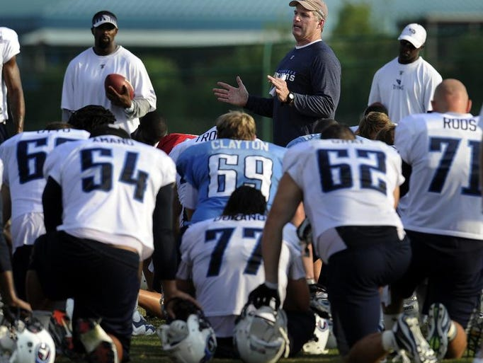 Tennessee Titans head coach Mike Munchak, center, talks with his team after practice at Baptist Sports Park Aug. 22, 2011. Munchak gave the players a treat when he decided to end training camp one day earlier than expected.