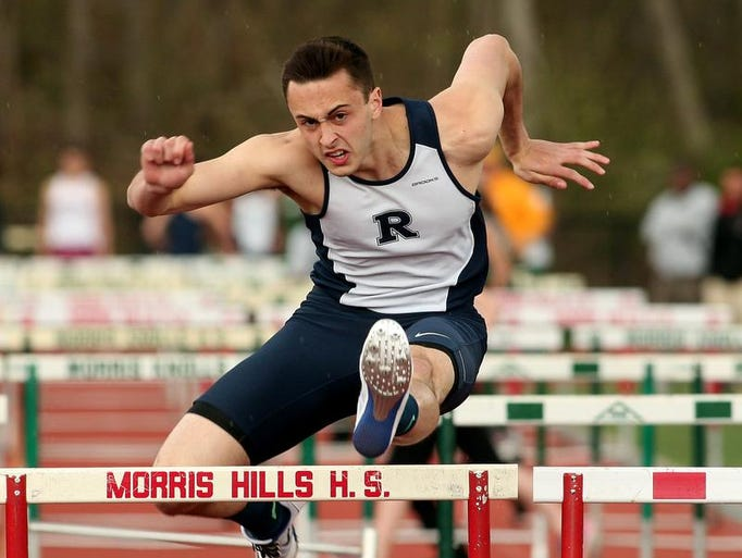 Randolph's Dan Leanza clears a hurdle during the William Hopkins Memorial Shuttle Hurdles at the Morris County Relays Championships at Morris Knolls High School. May 3, 2014, Denville, NJ.