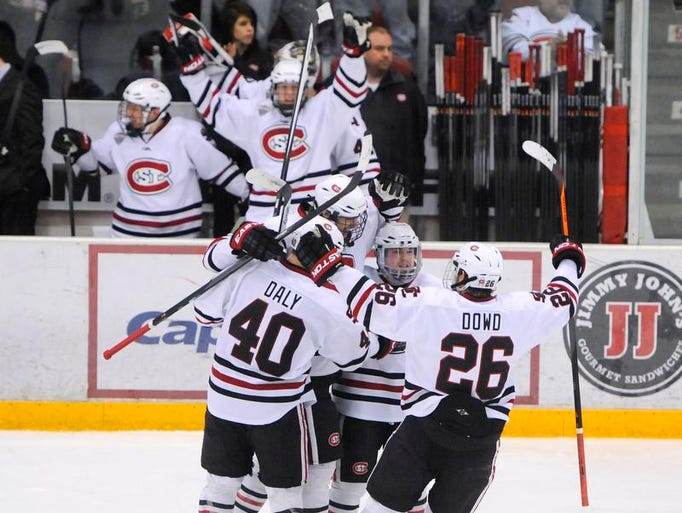 St. Cloud State players celebrate their first goal of the second period during Saturday's game against Miami (Ohio) at the Herb Brooks National Hockey Center in St. Cloud.