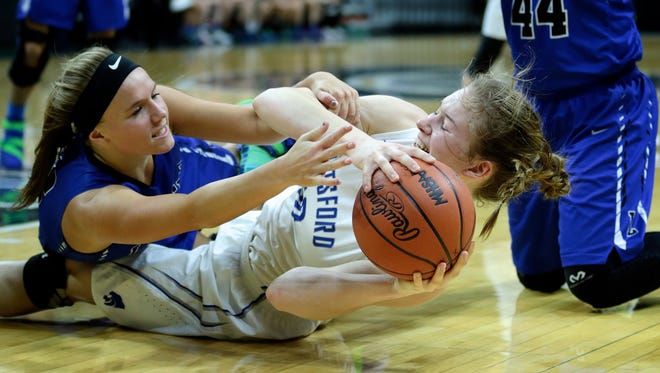 Waterford Our Lady's Megan Ross (12) and Pittsford's Maddie Clark (10) fights for the ball during Pittsford 62-43 win in Girls Basketball Class D Semifinal on Thursday, March 17, 2016, at the Breslin Center in East Lansing, MI.