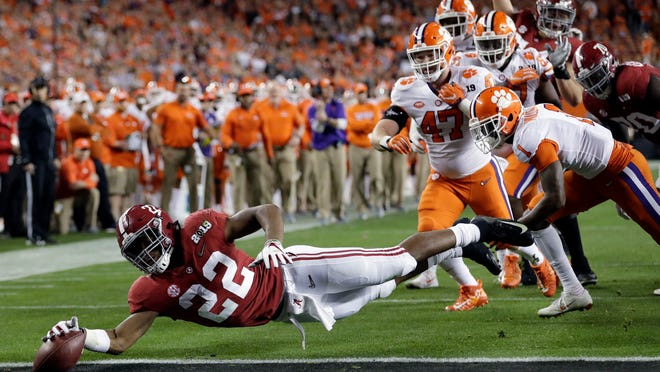 In this Jan. 7, 2019, file photo, Alabama's Najee Harris reaches for the end zone during the first half the NCAA college football playoff championship game against Clemson, in Santa Clara, Calif. After the Power Five conference commissioners met Sunday, Aug. 9, 2020, to discuss mounting concern about whether a college football season can be played in a pandemic, players took to social media to urge leaders to let them play.