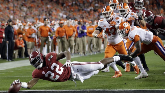FILE - In this Jan. 7, 2019, file photo, Alabama's Najee Harris reaches for the end zone during the first half the NCAA college football playoff championship game against Clemson, in Santa Clara, Calif. After the Power Five conference commissioners met Sunday, Aug. 9, 2020, to discuss mounting concern about whether a college football season can be played in a pandemic, players took to social media to urge leaders to let them play.