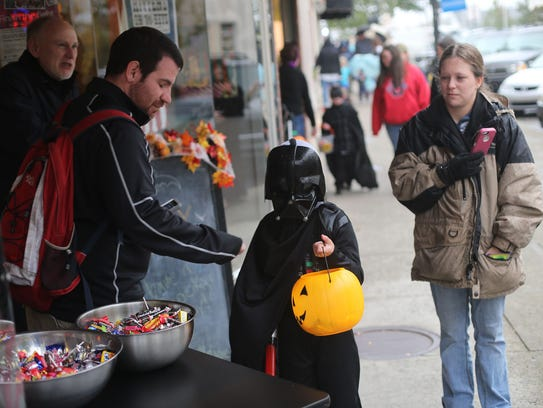Halloween trick-or-treating on the Public Square is