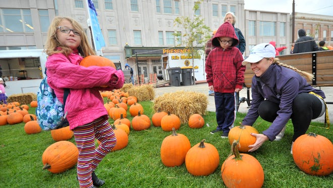 Picking pumpkins at the 2014 Harvest Fest at the 400 Block in downtown Wausau.