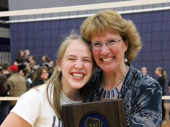 Lake Country Lutheran coach Janet Bahr poses with the sectional-title plaque along with team manager (and daughter) Lindsey Bahr.