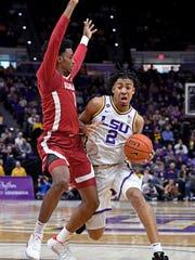 LSU forward Trendon Watford (2) drives to the basket around Alabama guard Herbert Jones (1) in the first half of an NCAA college basketball game, Wednesday, Jan. 29, 2020, in Baton Rouge, La. LSU won 90-76. (AP Photo/Bill Feig)