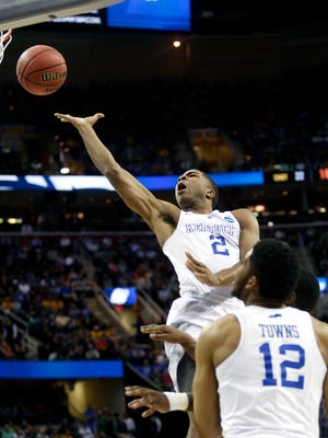 Kentucky Aaron Harrison stretches for two against West Virginia. March 26, 2015