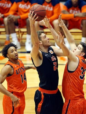 UTEP's Hooper Vint shoots between UTSA's Ryan Bowie, left, and James Ringholt during first half action Saturday at the Convocation Center in San Antonio.