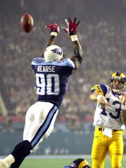 St. Louis Rams quarterback Kurt Warner (13) attempts a pass as Tennessee Titans defensive end Jevon Kearse (90) attempts to block it in the third quarter during Super Bowl XXXIV in Atlanta, Sunday Jan.30, 2000.