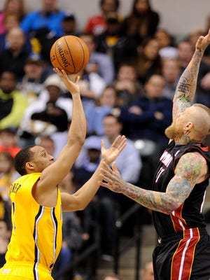 Indiana Pacers guard George Hill attempts a floater of Miami Heat forward Chris Andersen inside Bankers Life Fieldhouse, Wednesday, March 26, 2014, in Indianapolis. The Pacers won the game 84-83.