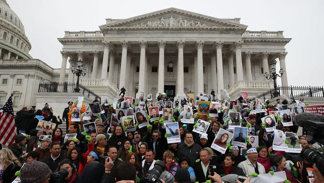 Dreamers protest in front of the Senate side of the U.S. Capitol to urge Congress to preserve the Deferred Action for Childhood Arrivals (DACA) program, on December 6, 2017, in Washington, D.C.