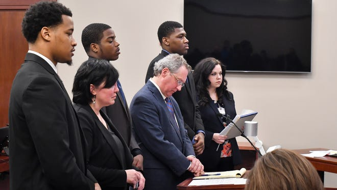 From left.  Former MSU football players Demetric Vance, Donnie Corley, and Josh King, appear in Ingham County Circuit Court Judge Rosemarie Aquilina's courtroom Wednesday, April 4, 2018, with their attorneys Mary Chartier, John Shea, and Shannon Smith.  They were accused of sexually assaulting a female student during a party at a campus apartment in January 2017.  All three pleaded guilty to lesser charges of seduction as part of an agreement with prosecutors.