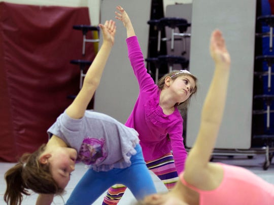 Showell Elementary students work on yoga poses in an