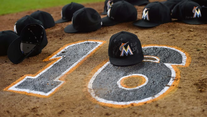 The Marlins' hats are left on the pitchers mound after Miami's win to honor Jose Fernandez at Marlins Park.