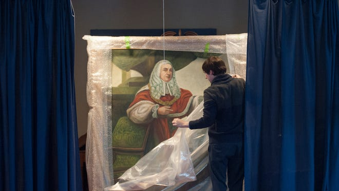 Collection Preservation Director, Josh Lisowski, unveils a the recently restored Lord Camden portrait at the Camden County Historical Society, 1900 Park Blvd.