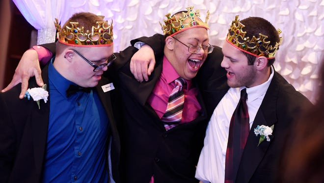 From left, Aaron Heim of York Township, Jose Waltz of Manchester Township, and Ken Frey of Wrightsville get ready in the Shining Star Photo Booth during Night to Shine, a prom experience for people with special needs. Friendship Community Church of Dover was one of more than 100 churches worldwide hosting a Night to Shine prom sponsored by the Tim Tebow Foundation.