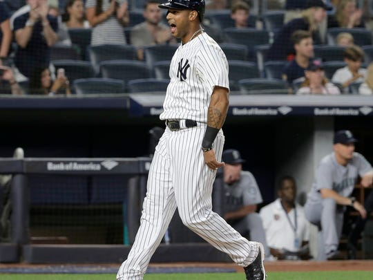 New York Yankees' Aaron Hicks reacts after scoring on a single hit by Aaron Judge during the fifth inning of a baseball game against the Seattle Mariners at Yankee Stadium Wednesday, June 20, 2018, in New York. (AP Photo/Seth Wenig)